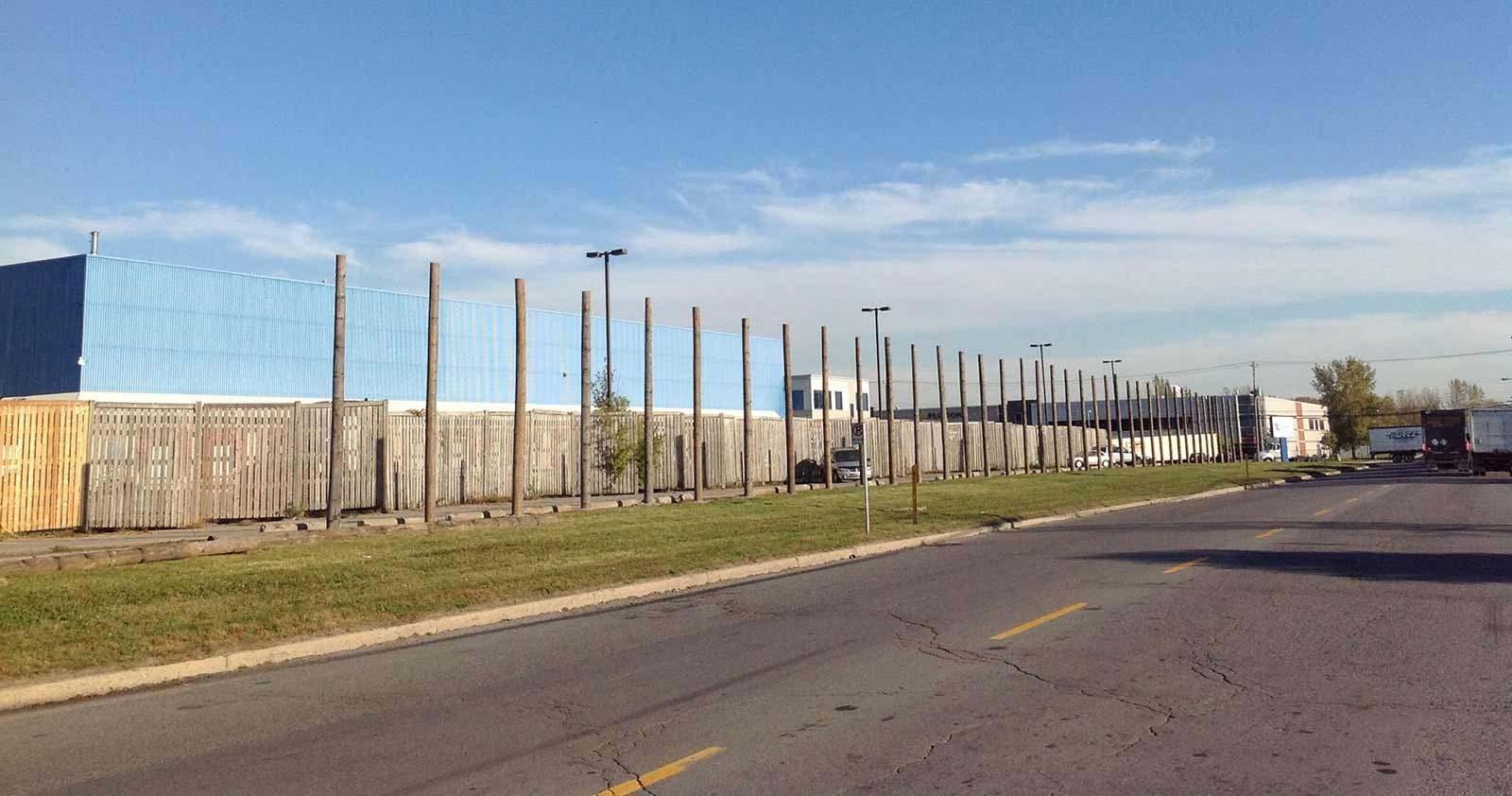 Réalisation d'une clôture de poteaux à Pointe-Claire - Laporte & Fils